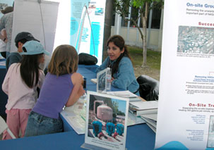 photo of visitors at booth